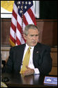 """President George W. Bush takes part in a roundtable with Iraq provincial reconstruction team leaders in the Dwight D. Eisenhower Executive Office Building Thursday, March 22, 2007. """"We don't want you to go into Iraq and then have unnecessary strings placed upon the money so you can't do your job,"""" said the President to the press. """"Congress needs to get their business done quickly, get the monies we've requested funded, and let our folks on the ground do the job."""" White House photo by Joyce N. Boghosian"""