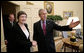 President George W. Bush welcomes Prime Minister Helen Clark of New Zealand to the Oval Office Wednesday, March 21, 2007. White House photo by Eric Draper