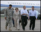 President George W. Bush and Laura Bush walk with Lt. General Russel Honore, left, and Plaquemines Parish president Benny Rousselle, right, upon their arrival Monday, Oct. 10, 2005 at the U.S. Naval Air Station, Joint Reserve Base in New Orleans, La.  White House photo by Eric Draper