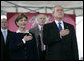 President George W. Bush and Mrs. Laura Bush stand for the National Anthem during the Christening Ceremony of the George H.W. Bush (CVN 77) in Newport News, Virginia, Saturday, Oct. 7, 2006. White House photo by Eric Draper