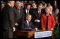 """President George W. Bush signs H. R. 1, the Medicare Prescription Drug, Improvement and Modernization Act of 2003, at Constitution Hall in Washington, D.C., Dec. 8, 2003. """"With this law, we are providing more access to comprehensive exams, disease screenings, and other preventative care, so that seniors across this land can live better and healthier lives,"""" said President Bush.  White House photo by Paul Morse"""