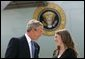 President George W. Bush talks with Freedom Corps Greeter Amy Bickel in front of Air Force One at Des Moines International Airport-Air National Guard Base, Tuesday, Aug. 31, 2004. Bickel co-founded the Central Iowa Young Women's Leadership Institute to help high school girls develop strong leadership skills and a commitment to community service.  White House photo by Eric Draper