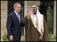 """President George W. Bush welcomes Crown Prince Abdullah of Saudi Arabia to the Bush family ranch in Crawford, Texas, Thursday, April 25. """"The Crown Prince is going to be in America for several more days, and officials from both our governments will be continuing our discussions with the hope that our efforts can help return us to the path of peace -- a lasting peace,"""" said the President in a press conference after the visit. White House photo by David Bohrer."""