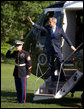 President George W. Bush waves from the steps of Marine One Tuesday, May 13, 2008 on the South Lawn of White House, as he departs on a five-day trip to Israel, Saudi Arabia and Egypt. White House photo by Eric Draper