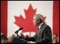 """President George W. Bush delivers a speech at Pier 21, Canada's celebrated point of immigration and military deployment, in Halifax, Canada, Dec. 1, 2004. """"I'm proud to stand in this historic place, which has welcomed home so many Canadians who defended liberty overseas, and which so many new Canadians began their North American dream,"""" said the President. White House photo by Paul Morse"""