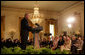"""President George W. Bush joins in the celebration of International Women's Day at the White House Tuesday, March 7, 2006, as he thanks the female members of his audience for their leadership. """"The struggle for women's right is a story of strong women willing to take the lead,"""" the President told them and added, America's """"a better place because of the leadership of women throughout our history.""""  White House photo by Shealah Craighead"""
