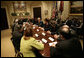 President George W. Bush speaks with participants in a meeting on immigration reform Thursday, March 23, 2006, in the Roosevelt Room of the White House.  White House photo by Eric Draper