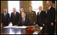 """President George W. Bush smiles after signing the Presidential proclamation designating the World War II Valor in the Pacific National Monument and the Presidential proclamation in honor of National Pearl Harbor Remembrance Day 2008 in the Oval Office of the White House. With him for the signing Friday, Dec. 5, 2008, are from left: Pearl Harbor Survivor Jay Groff; George Sullivan, Chairman, Arizona Memorial Museum Association; Secretary Donald Winter, U.S. Department of the Navy; Gen. James """"Hoss"""" Cartwright, Vice Chairman, Joint Chiefs of Staff; Secretary James Peake, U.S. Department of Veterans Affairs, and Secretary Dirk Kempthorne, U.S. Department of the Interior. White House photo by Eric Draper"""