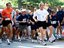 President George W. Bush competes in the 3 mile run as part of The President's Fitness Challenge at Ft. McNair on Saturday June 21, 2002. White House photo by Paul Morse.