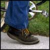 Photo of foot peddling a bicycle.