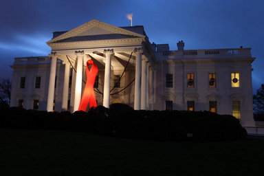 A red ribbon adorns the North Portico of the White House at dawn Monday, Dec. 1, 2008, in recognition of World AIDS Day and the commitment by President George W. Bush and his administration to fighting and preventing HIV/AIDS in America and the world. White House photo by Chris Greenberg