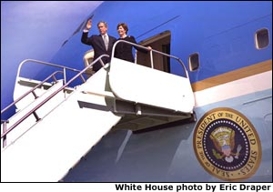 President George W. Bush and Laura Bush board Air Force One after attending a memorial service for the crew of the U.S. Space Shuttle Columbia at NASA's Lyndon B. Johnson Space Center in Houston, Texas, Tuesday, Feb. 4, 2003.
