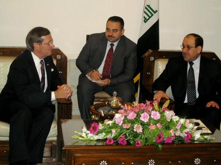 Secretary Leavitt (left); interpreter (middle); Prime Minister of the Republic of Iraq, Nouri Kamel al-Maliki (right)