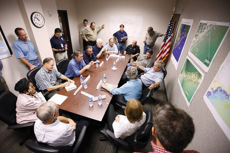 President George W. Bush speaks with state and local officials during a briefing Tuesday, Sept. 16, 2008, at the Galveston emergency operations center.