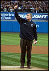 President George W. Bush throws out the first pitch during game three of the World Series game between the Arizona Diamondbacks and the Yankees at Yankee Stadium Oct. 3, 2001.