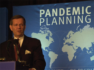 HHS Secretary Michael O. Leavitt addresses a conference on planning for  an eventual influenza pandemic.