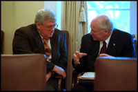 Vice President Cheney speaks with Speaker of the House Dennis Hastert in the Cabinet Room following a meeting about the military with members of Congress January 23, 2002.
