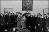 Within hours of President Franklin Roosevelt's death, Vice President Harry Truman takes the oath of office in a brief ceremony in the Cabinet Room April 12, 1945.