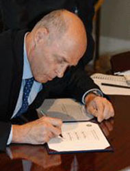 Photo: Secretary Paulson shown here in his first day in office provides his signature for the Bureau of Engraving and Printing – the Treasury agency responsible for printing all of the nation's currency.