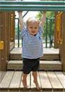 Boy on climbing equipment