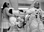 Apollo 10 commander pats stuffed Snoopy.