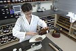 Herbalist weighing dried herbs. © Bob Stockfield