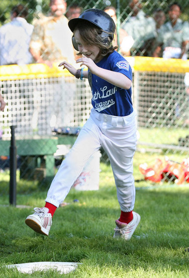 Stars player Bridget Donahue of Westborough, Mass., leaps for home plate during action in the Tee Ball on the South Lawn: A Salute to the Troops game Sunday, Sept. 7, 2008 at the White House, played by the children of active-duty military personnel. White House photo by Joyce N. Boghosian