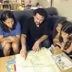 Photo of family making plans to shelter in place