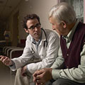 Young doctor and older gentleman in waiting room. Copyright 2008 Jupiterimages Corporation