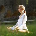 Woman meditating by stream. Copyright Getty Images