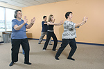 A community group practices Tai Chi, a mind-body practice that originated in China as a martial art. © Bob Stockfield