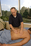 A back massage involves manipulation of the muscles and other soft tissues. © Bob Stockfield