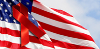 Image of American flag with red-ribbon on top.