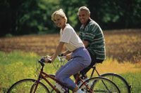 Image of a man and a woman riding bikes