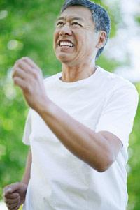 photo of asian man speed-walking