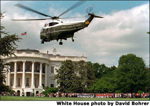President George W. Bush arrives aboard Marine One for a tee-ball game on the South Lawn.