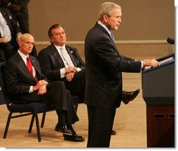 President George W. Bush delivers remarks during a commemoration Thursday, March 6, 2008, of the 5th anniversary of the U.S. Department of Homeland Security. Joining him on stage at Constitution Hall in Washington, D.C., are Secretary Michael Chertoff, left, of the Department of Homeland Security, and former Secretary of DHS Tom Ridge. White House photo by Chris Greenberg