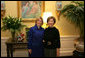 Mrs. Laura Bush poses Tuesday, Dec. 16, 2008, with Mrs. Ana Ligia Mixco Sol de Saca, wife of El Salvador's President Elias Antonio Saca, after Mrs. Saca's arrival in the Residence of the White House for a coffee. White House photo by Shealah Craighead