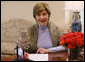 """Taking the opportunity to speak about American Heart Month, Mrs. Laura Bush delivers the weekly radio address from her office in the White House. Said Mrs. Bush, """"This American Heart Month, all of us can be Heart Truth ambassadors. Start by protecting your own heart, and spread the word to others. February is a month known for Valentines. This February, encourage your loved ones to take care of their health. It's the best Valentine's gift you could possibly give."""" White House photo by Shealah Craighead"""