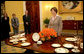Mrs. Laura Bush meets reporters as she announces two new White House china patterns, Wednesday, Jan. 7, 2009 in the Family Dining Room of the State Floor of the White House for their unveiling of the George W. Bush State China and the Magnolia Residence China. The George W. Bush State China was inspired from a Madison-era dinner service. The Magnolia Residence China is in the picture foreground and the George W. Bush State China is on the left side of the table. With Mrs. Bush from left are Amy Zantzinger, White House Social Secretary, Nancy Clarke, White House Florist, and Bill Allman, White House Curator. White House photo by Shealah Craighead