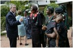 President George W. Bush talks with women who are members of Women and Children of Hope and the Nigerian Community of Western Living with AIDS at National Hospital in Abuja, Nigeria on July 12, 2003.