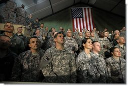 """Troops at Bagram Air Base listen to remarks by President George W. Bush early Monday, Dec. 15, 2008, after his arrival in Afghanistan. The President told his audience, """"I am confident we will succeed in Afghanistan because our cause is just, our coalition and Afghan partners are determined; and I am confident because I believe freedom is a gift of an Almighty to every man, woman, and child on the face of the Earth. Above all, I know the strength and character of you all. As I conclude this final trip, I have a message to you, and to all who serve our country: Thanks for making the noble choice to serve and protect your fellow Americans.""""  White House photo by Eric Draper"""
