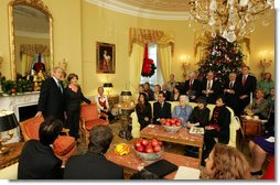 President George W. Bush and Mrs. Laura Bush stand in the Yellow Oval Room in the Private Residence of the White House Thursday, Dec. 18, 2008, after the President dropped in on a coffee in honor of the U.S. Afghan Women's Council. White House photo by Joyce N. Boghosian