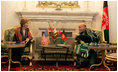 Afghan President Hamid Karzai jokes with Laura Bush during a meeting in the Presidential Palace in Kabul, Afghanistan, Wednesday, March 30, 2005.