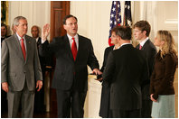 President George W. Bush looks on during the swearing-in ceremony for U.S. Supreme Court Justice Samuel A. Alito, Tuesday, Feb. 1, 2006 in the East Room of the White House, sworn-in by U.S. Supreme Court Chief Justice John Roberts. Alito's wife, Martha-Ann, their son Phil and daughter, Laura, are seen to the right.