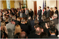 President George W. Bush welcomes an audience to the swearing-in ceremony for U.S. Supreme Court Justice Samuel A. Alito, Tuesday, Feb. 1, 2006 in the East Room of the White House, joined by Altio's wife, Martha-Ann, their son Phil, daughter, Laura, and U.S. Supreme Court Justice John Roberts.