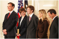 U.S. Supreme Court Justice Samuel A. Alito is seen, Tuesday, Feb. 1, 2006 in the East Room of the White House, with his wife, Martha-Ann, their son Phil, daughter, Laura, and U.S. Supreme Court Chief Justice John Roberts prior to being sworn-in.