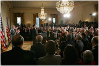 President George W. Bush, left, listens as newly confirmed U.S. Supreme Court Justice Samuel Alito addresses an audience, Tuesday, Feb. 1, 2006 in the East Room of the White House, prior to being sworn-in by U.S. Supreme Court Chief Justice John Roberts.