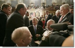 President George W. Bush is surrounded by members of Congress as he prepares to leave the House chamber Monday evening, Jan. 28, 2008 at the U.S. Capitol, following the President's State of the Union Address. White House photo by Eric Draper
