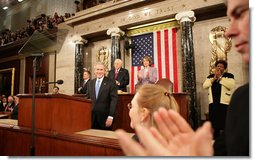 President George W. Bush acknowledges the applause Monday, Jan. 28, 2008, as he arrives at the podium on the House floor at the U.S. Capitol to deliver his final State of the Union address. White House photo by Eric Draper